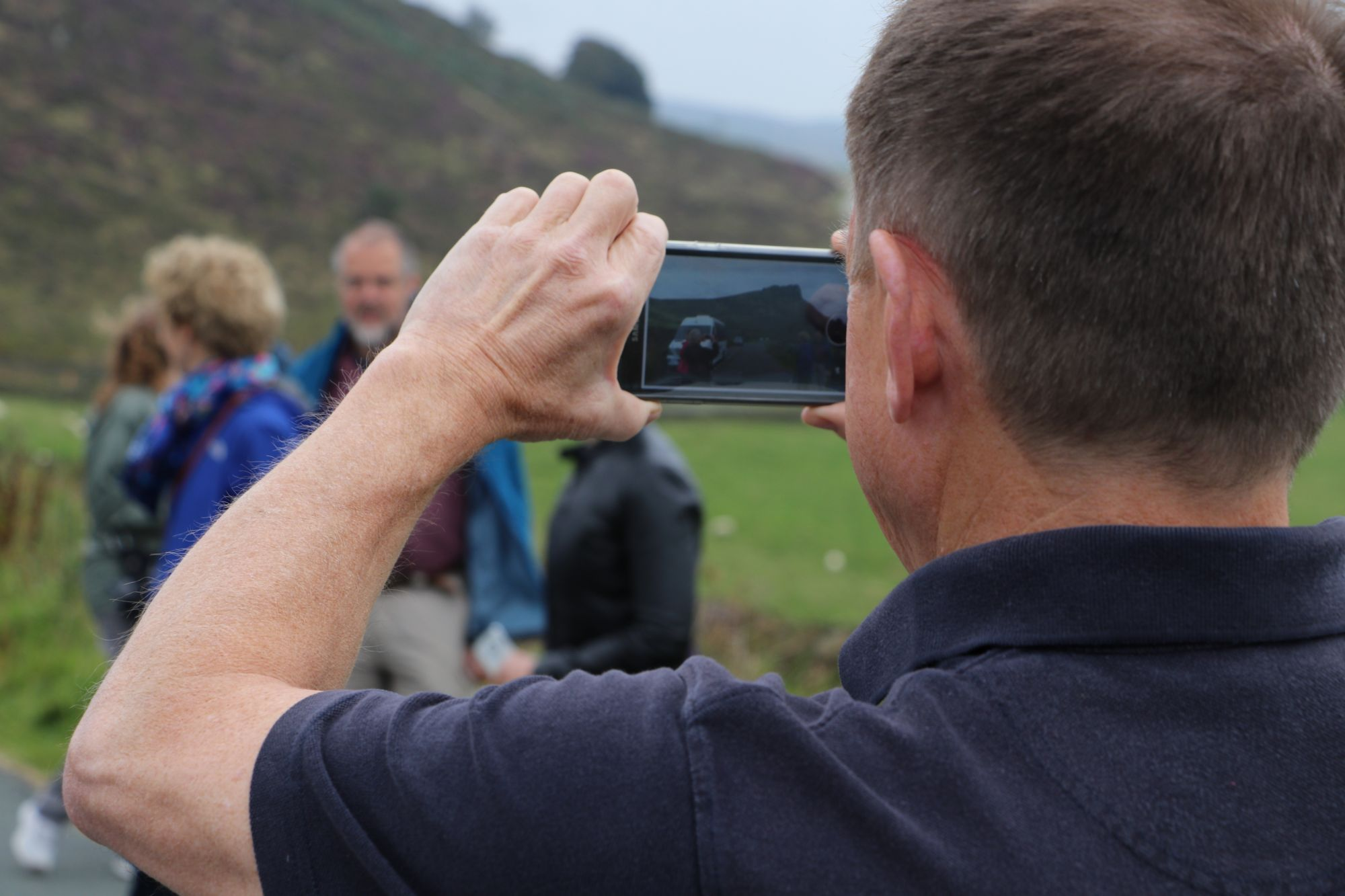 Steve taking a photo on iPhone